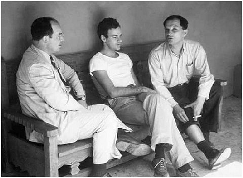 Black and white photo: von Neumann, Feynman, and Ulam on the porch of Bandelier lodge in Frijoles Canyon, New Mexico, during a picnic, ca 1949 (Nicholas Metropolis)